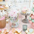 Wedding decoration with pastel colored cupcakes, meringues, muffins and macarons. Elegant and luxurious event arrangement with colorful macaroons. Wedding dessert with macaroons — Stock Photo #50537873