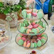 Wedding decoration with pastel colored cupcakes, meringues, muffins and macarons. Elegant and luxurious event arrangement with colorful macaroons. Wedding dessert with macaroons — Stock Photo #50586337