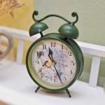 Vintage green colored clock. Retro alarm clock. Vintage alarm clock. — Stock Photo #50586353