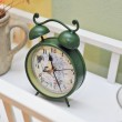 Vintage green colored clock. Retro alarm clock. Vintage alarm clock. — Stock Photo #50586355