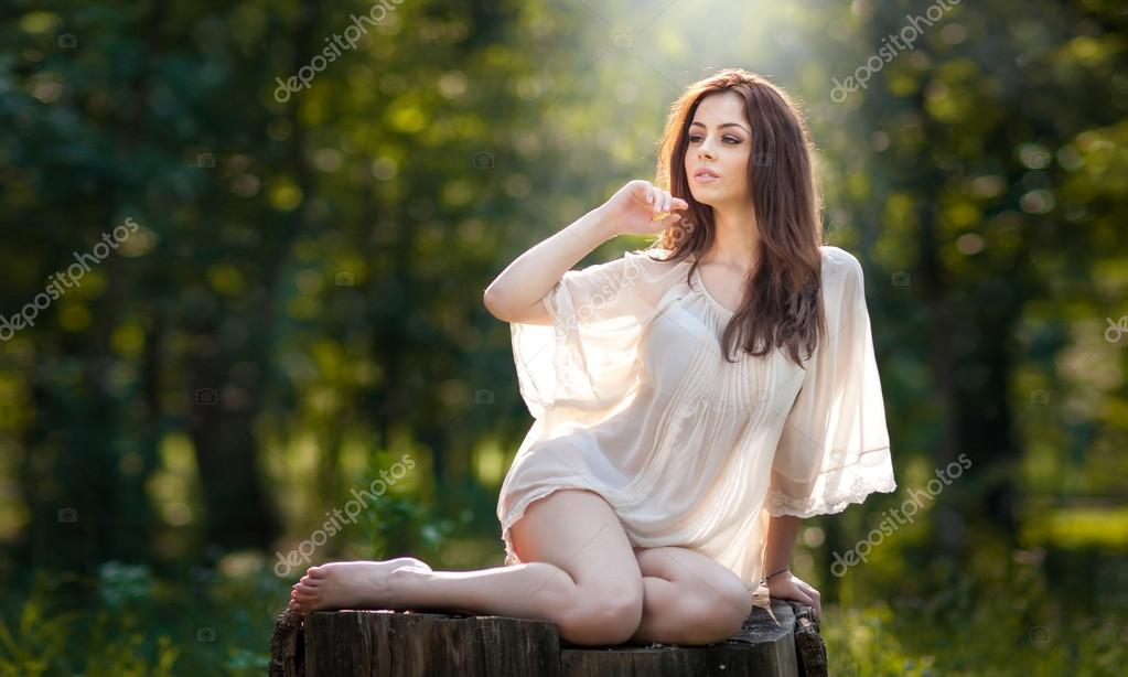 Young beautiful red hair woman wearing a transparent white ...