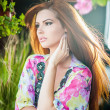 Beautiful female portrait with long red hair outdoor. Genuine natural redhead with bright colored blouse in park. Portrait of a attractive woman with beautiful eyes daydreaming, outdoor shot — Stock Photo #51755227