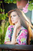 Beautiful female portrait with long red hair outdoor. Genuine natural redhead with bright colored blouse in park. Portrait of a attractive woman with beautiful eyes daydreaming, outdoor shot — 图库照片