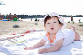 Baby girl on the beach — Стоковое фото