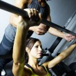 Personal Trainer Spotting a Woman Lifting Weights — Stock Photo