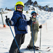 Children on the snowy ski slopes — Stock Photo