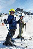 Children on the snowy ski slopes — Stock Photo