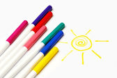Colour felt-tip pens and sun — Stock Photo