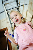 The little girl on a sports swing — Stock Photo