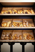 Shelves with bread at store — Stock Photo