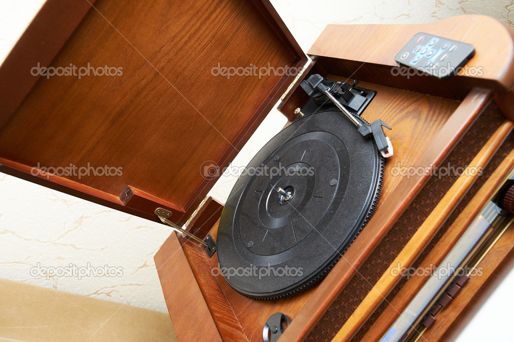 Old vinyl wooden record-player and remove control  Stock Photo #13956622