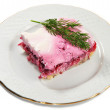 Layered salad of herring, potatoes, beets and mayonnaise — Stock Photo