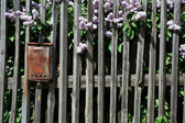 Old wooden fence in the Russian village — Stock Photo