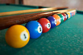 Billiard balls on green table — Stockfoto