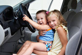 Young children are driving big cars — Stock Photo