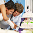 Bride and groom cut the wedding cake — Stock Photo