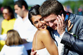 Bride and groom received congratulations on the phone — Stock Photo