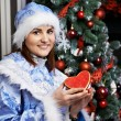Royalty-Free Stock Photo: Young woman with Christmas costume Snow Maiden