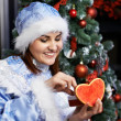 Royalty-Free Stock Photo: Happy woman with Christmas costume receives gift