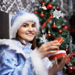 Stock Photo: Young womwith Christmas costume Snow-Maiden