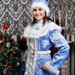Young woman with a Christmas costume Snow Maiden — Foto de Stock
