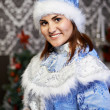 Young woman with a Christmas costume Snow Maiden — Stockfoto