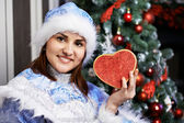 Young woman with a Christmas costume with red heart — Stock Photo