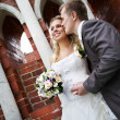 Happy bride and groom in park — Stock Photo
