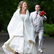 Groom runs after the bride — Stock Photo