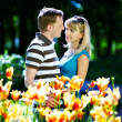 Man and girl among flowers - Stock Photo