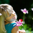 Portrait beautiful woman among flowers — Stock Photo