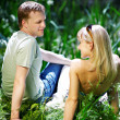 Lovers couple on the shore of the pond — Stock Photo