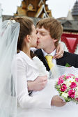 Kiss bride and groom — Stock Photo