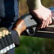 Shotgun in hand hunter — Stock Photo