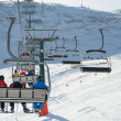 View of the ski slopes and people on chair lifts — Foto Stock