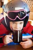 Child skier drinking tea — Stock Photo