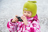 Funny little girl with camera — Stock Photo