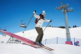 Woman riding in skiing — Stock Photo