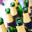 Many empty bottles of champagne — Stock Photo #35391033