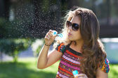 Young girl and bursting of bubble — Stock Photo