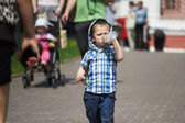 Little boy drinking from plastic bottle — Stock Photo