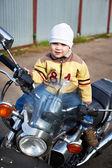 Little boy sits on motorcycle — Foto de Stock