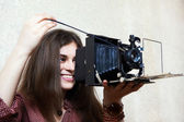 Young girl with old camera rarity — Stock Photo