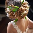 Hairstyle woven with flowers lily — Stock Photo