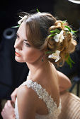 Hairstyle beauty girl woven with flowers lily — Stock Photo