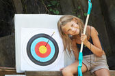 Girl with bow and sports aim — Stock Photo