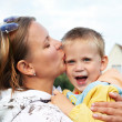 Happy mother kissing baby — Stock Photo