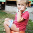 Little boy on chamber pot — Stock Photo