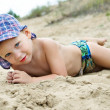 Little boy lying on the sand — Stock Photo