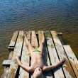 Little girl sunbathing on a raft — Stock Photo